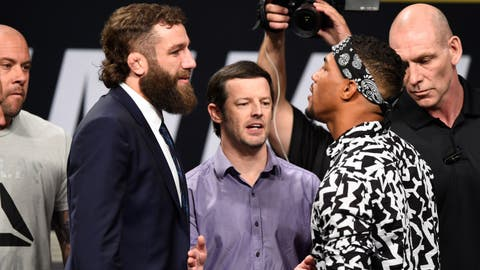 Michael Chiesa and Kevin Lee come to blows after heated exchange
