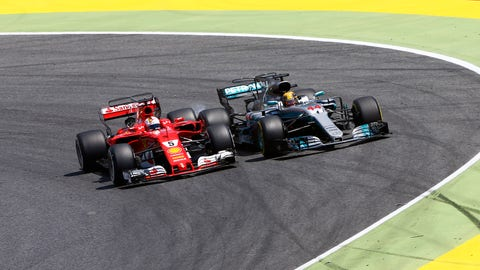 Sebastian Vettel bangs wheels with Lewis Hamilton after emerging from his stop. (Photo: Andy Hone/LAT Images)