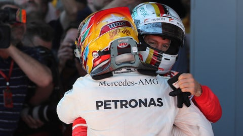 Lewis Hamilton and Sebastian Vettel congratulate each other after finishing first and second at the Spanish GP. (AP Photo/Emilio Morenatti)