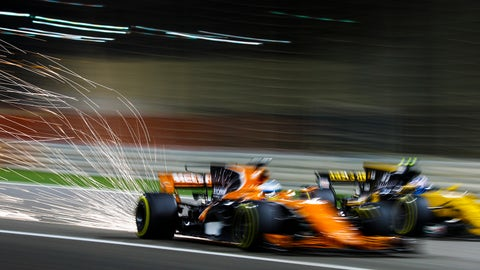 Sparks fly as McLaren and Renault go wheel-to-wheel at the Bahrain GP. (Photo: Steven Tee/LAT Images)