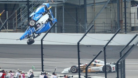 Scott Dixon's car crashes over the top of Jay Howard's car at the Indianapolis 500. (Photo: Mark J. Rebilas-USA TODAY Sports)