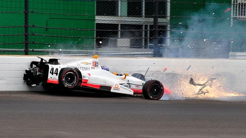 Buddy Lazier makes hard contact with the wall in Turn 2. (AP Photo/John Maxwell)