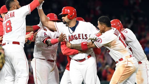 May 16, 2017; Anaheim, CA, USA; Los Angeles Angels designated hitter Albert Pujols (5) celebrates hitting the game winning RBI single against the Chicago White Sox in the eleventh inning at Angel Stadium of Anaheim. Mandatory Credit: Richard Mackson-USA TODAY Sports