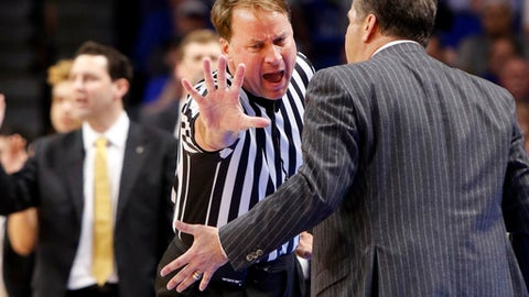 FILE - In this Feb. 28, 2017, file photo, Kentucky head coach John Calipari, right, address official John Higgins after being assessed a technical foul during the second half of an NCAA college basketball game against Vanderbilt, in Lexington, Ky. Referee John Higgins of Omaha has contacted law enforcement to report he's received death threats after Kentucky's loss to North Carolina in the NCAA South Regional final.A person with knowledge of the situation told The Associated Press that Higgins reported threats on his home phone, which has an unlisted number, and on the office phone for his roofing company. The person requested anonymity because the investigation is ongoing. (AP Photo/James Crisp, File)