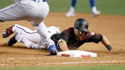 Arizona Diamondbacks' A.J. Pollock, right, dives safely back to first around Los Angeles Dodgers' Scott Van Slyke on a pick-off attempt during the eighth inning of a baseball game, Saturday, April 22, 2017, in Phoenix. (AP Photo/Ralph Freso)