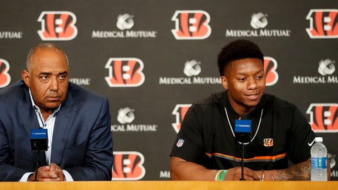 Cincinnati Bengals second-round draft pick Joe Mixon, right, is interviewed alongside head coach Marvin Lewis, left, during a news conference at Paul Brown Stadium, Saturday, April 29, 2017, in Cincinnati. The former Oklahoma running back was selected as the 48th overall pick. (AP Photo/John Minchillo)