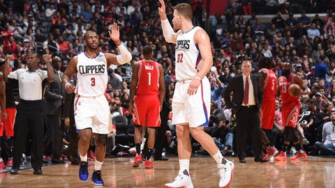 LOS ANGELES, CA - APRIL 10:  Chris Paul #3 and Blake Griffin #32 of the LA Clippers high-five during a game against the Houston Rockets on April 10, 2017 at STAPLES Center in Los Angeles, California. NOTE TO USER: User expressly acknowledges and agrees that, by downloading and/or using this photograph, user is consenting to the terms and conditions of the Getty Images License Agreement. Mandatory Copyright Notice: Copyright 2017 NBAE (Photo by Andrew D. Bernstein/NBAE via Getty Images)