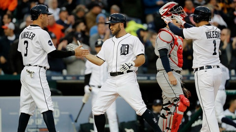 Detroit Tigers' Tyler Collins, center, celebrates his three-run home run with Ian Kinsler (3) and Jose Iglesias (1) as Cleveland Indians catcher Roberto Perez looks on in the second inning of a baseball game in Detroit, Monday, May 1, 2017. (AP Photo/Paul Sancya)