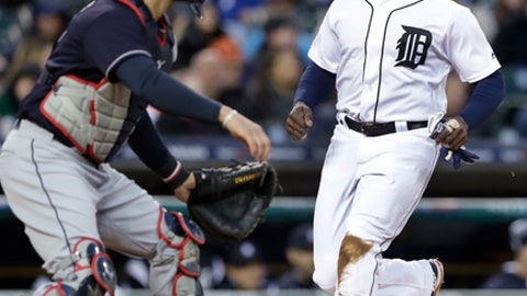 Detroit Tigers' Justin Upton scores ahead of the throw to Cleveland Indians catcher Yan Gomes during the third inning of a baseball game, Tuesday, May 2, 2017, in Detroit. (AP Photo/Carlos Osorio)