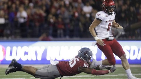 Eastern Washington quarterback Gage Gubrud (8) tries to get away from Washington State linebacker Derek Moore (55) during the second half of an NCAA college football game in Pullman, Wash., Saturday, Sept. 3, 2016. Eastern Washington won 45-42. (AP Photo/Young Kwak)