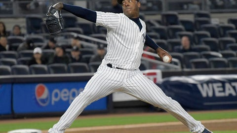 New York Yankees relief pitcher Aroldis Chapman throws to a Toronto Blue Jays batter during the ninth inning of a baseball game Wednesday, May 3, 2017, at Yankee Stadium in New York. Chapman got the save as the Yankees won 8-6. (AP Photo/Bill Kostroun)
