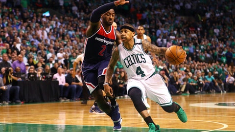 BOSTON, MA - MAY 2: Isaiah Thomas #4 of the Boston Celtics drives against John Wall #2 of the Washington Wizards during the fourth quarter of Game Two of the Eastern Conference Semifinals at TD Garden on May 2, 2017 in Boston, Massachusetts. The Celtics defeat the Wizards 129-119. NOTE TO USER: User expressly acknowledges and agrees that, by downloading and or using this Photograph, user is consenting to the terms and conditions of the Getty Images License Agreement. (Photo by Maddie Meyer/Getty Images)