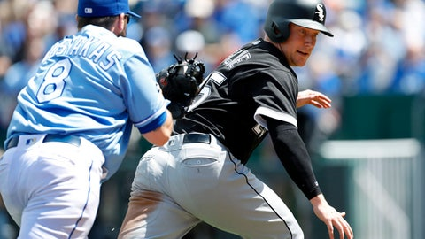 Chicago White Sox's Cody Asche, right, is caught in a rundown between third and home plate by Kansas City Royals third baseman Mike Moustakas (8) during the fourth inning of a baseball game at Kauffman Stadium in Kansas City, Mo., Thursday, May 4, 2017. (AP Photo/Colin E. Braley)