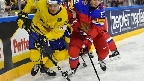 Sweden's forward Joel Eriksson Ek, left, and Russia's forward Vladislav Namestnikov challenge for the puck at the Ice Hockey World Championships group A match between Sweden and Russia in the LANXESS arena in Cologne, Germany, Friday, May 5, 2017. (AP Photo/Martin Meissner)