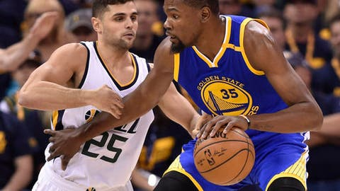 SALT LAKE CITY UT- MAY 6 Raul Neto #25 of the Utah Jazz defends against Kevin Durant #35 of the Golden State Warriors in the first half in Game Three of the Western Conference Semifinals during the 2017 NBA Playoffs at Vivint Smart Home Arena on May 6