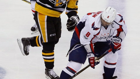 Washington Capitals' Alex Ovechkin (8) backhands a pass with Pittsburgh Penguins' Sidney Crosby (87) behind him during the period of Game 6 in an NHL Stanley Cup Eastern Conference semifinal hockey game in Pittsburgh, Monday, May 8, 2017. (AP Photo/Gene J. Puskar)