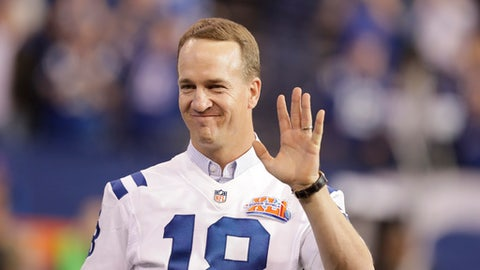 Former Indianapolis Colts quarterback Peyton Manning claps as the team honored the 2006 Super Bowl winning team during half time of an NFL football game in Indianapolis, Sunday, Nov. 20, 2016. (AP Photo/Darron Cummings)