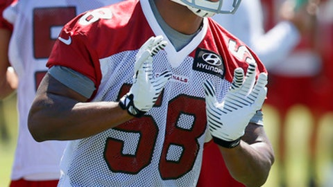 FILE - In this May 20, 2014 file photo, Arizona Cardinals' Daryl Washington works on drills with teammates during an NFL football organized team activity in Tempe, Ariz. The NFL has suspended Washington for one year for violating the league's substance abuse policy. The punishment, announced Friday, May 30, 2014, was for substance abuse and did not mention his recent guilty plea to assaulting his ex-girlfriend.(AP Photo/Ross D. Franklin, File)