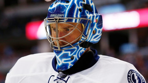 FILE - In this Feb. 19, 2017, file photo, then-Tampa Bay Lightning goalie Ben Bishop (30) is shown during overtime of an NHL hockey game against Colorado, in Denver. The Dallas Stars have signed goaltender Ben Bishop to a six-year, $29.5-million deal. General manager Jim Nill announced the terms Friday, May 12, 2017, less than a week after acquiring rights to the 30-year-old Bishop from the Los Angeles Kings for a fourth-round pick in next month's draft. The 6-foot-7 Bishop played just seven games after the Kings acquired him from Tampa Bay. (AP Photo/David Zalubowski, File)