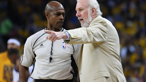 OAKLAND, CA - MAY 14:  Gregg Popovich of the San Antonio Spurs speaks with referee Marc Davis #8 during Game One of the NBA Western Conference Finals against the Golden State Warriors at ORACLE Arena on May 14, 2017 in Oakland, California. NOTE TO USER: User expressly acknowledges and agrees that, by downloading and or using this photograph, User is consenting to the terms and conditions of the Getty Images License Agreement.  (Photo by Thearon W. Henderson/Getty Images)