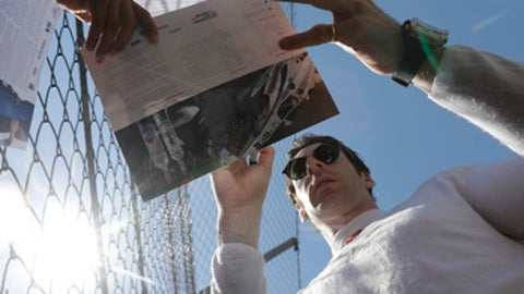 Simon Pagenaud, of France, signs autographs for fans before a practice session for the Indianapolis 500 IndyCar auto race at Indianapolis Motor Speedway, Tuesday, May 16, 2017 in Indianapolis. (AP Photo/Darron Cummings)