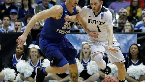 Butler's Tyler Lewis drives past Middle Tennessee State's Reggie Upshaw during the second half of an NCAA college basketball tournament second-round game Saturday, March 18, 2017, in Milwaukee. Butler won 74-65. (AP Photo/Morry Gash)