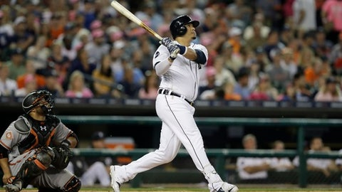 Detroit Tigers designated hitter Victor Martinez bats during the seventh inning of a baseball game against the Baltimore Orioles, Wednesday, May 17, 2017, in Detroit. (AP Photo/Carlos Osorio)