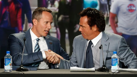 Chris Ilitch, Ilitch Holdings, President and CEO, left, and Detroit Pistons owner Tom Gores shake hands at a news conference in Detroit, Tuesday, Nov. 22, 2016. The Pistons announced they will move downtown Detroit and begin playing at the new Little Caesars Arena, home of the Detroit Red Wings, starting next season. (AP Photo/Paul Sancya)