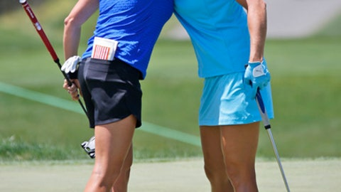 Gerina Piller, left, hugs Lexi Thompson on the ninth tee during the first round of the Kingsmill Championship LPGA golf tournament in Williamsburg, Va., Thursday, May 18, 2017. (AP Photo/Steve Helber)