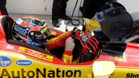Ryan Hunter-Reay dons his gloves as he prepares to drive during a practice session for the Indianapolis 500 IndyCar auto race at Indianapolis Motor Speedway, Thursday, May 18, 2017, in Indianapolis. (AP Photo/Michael Conroy)