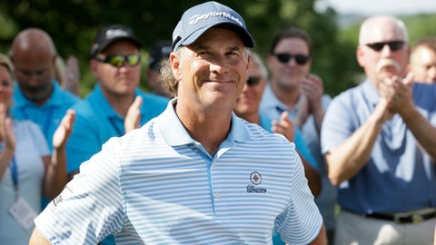 Scott McCarron reacts to the gallery after winning the PGA Tour Champions Principal Charity Classic golf tournament, Sunday, June 5, 2016, in Des Moines, Iowa. (AP Photo/Charlie Neibergall)