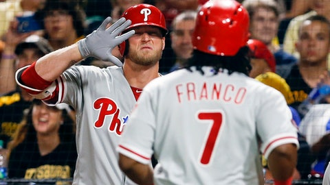 Philadelphia Phillies' Michael Saunders, left, greets Maikel Franco (7), who scored on a double by Jeremy Hellickson during the seventh inning of a baseball game against the Pittsburgh Pirates, Friday, May 19, 2017, in Pittsburgh. (AP Photo/Keith Srakocic)