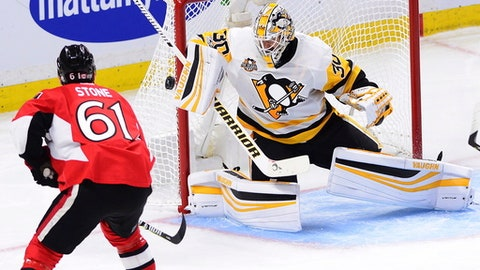Pittsburgh Penguins goalie Matt Murray (30) makes a save on Ottawa Senators right wing Mark Stone (61) during the second period of Game 4 of the NHL hockey Stanley Cup Eastern Conference finals, Friday, May 19, 2017, in Ottawa, Ontario. (Sean Kilpatrick/The Canadian Press via AP)