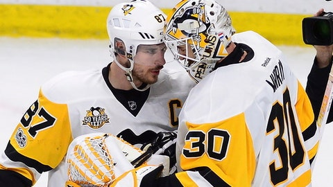 Pittsburgh Penguins center Sidney Crosby (87) celebrates with goalie Matt Murray (30) after the Penguins' 3-2 win over the Ottawa Senators during Game 4 of the NHL hockey Stanley Cup Eastern Conference finals, Friday, May 19, 2017, in Ottawa, Ontario. (Sean Kilpatrick/The Canadian Press via AP)