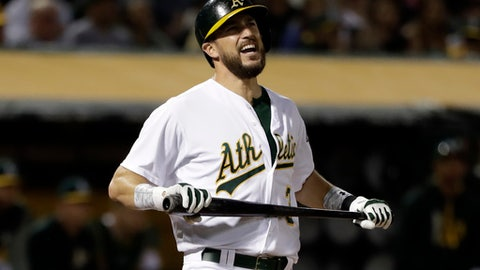 Oakland Athletics' Trevor Plouffe reacts after striking out against the Boston Red Sox during the sixth inning of a baseball game Friday, May 19, 2017, in Oakland, Calif. (AP Photo/Marcio Jose Sanchez)