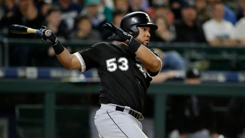 Chicago White Sox's Melky Cabrera watches his go-ahead RBI double in the 10th inning of a baseball game against the Seattle Mariners, Friday, May 19, 2017, in Seattle. Leury Garcia scored on the play. (AP Photo/Ted S. Warren)