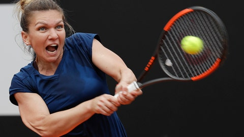 Romania's Simona Halep returns the ball during her semifinal match against Netherlands Kiki Bertens at the Italian Open tennis tournament, in Rome, Saturday, May 20, 2017. (AP Photo/Gregorio Borgia)
