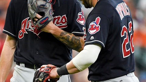Cleveland Indians starting pitcher Mike Clevinger, left, laughs with second baseman Jason Kipnis during a video review of Houston Astros' Josh Reddick's stolen base during the sixth inning of a baseball game, Saturday, May 20, 2017, in Houston. Reddick was ruled out on the play. (AP Photo/Eric Christian Smith)