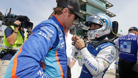 Tony Kanaan, right, of Brazil, talks with Scott Dixon, of New Zealand, during qualifications for the Indianapolis 500 IndyCar auto race at Indianapolis Motor Speedway, Saturday, May 20, 2017 in Indianapolis. (AP Photo/Michael Conroy)