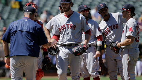 Boston Red Sox pitcher Ben Taylor center, hands the ball to manager John Farrell as he is relieved during the fifth inning of a baseball game against the Oakland Athletics in Oakland, Calif., Saturday, May 20, 2017. (AP Photo/Jeff Chiu)