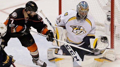 Nashville Predators goalie Pekka Rinne, right, makes a save with his glove off a shot by Anaheim Ducks center Andrew Cogliano, left, during the third period of Game 5 in the NHL hockey Stanley Cup Western Conference finals in Anaheim, Calif., Saturday, May 20, 2017. (AP Photo/Chris Carlson)
