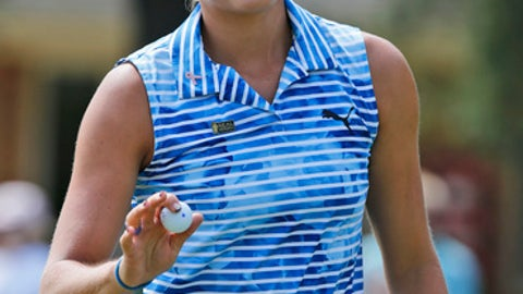 Lexi Thompson smiles as she tips her ball to the crowd after a first hole birdie during the final round of the Kingsmill Championship LPGA golf tournament in Williamsburg, Va., Sunday, May 21, 2017. (AP Photo/Steve Helber)