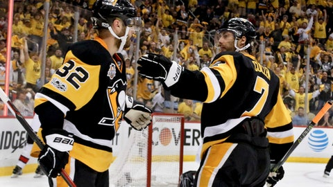 Pittsburgh Penguins' Matt Cullen (7) celebrates with Mark Streit (32) after scoring against the Ottawa Senators during the second period of Game 5 in the NHL hockey Stanley Cup Eastern Conference finals, Sunday, May 21, 2017, in Pittsburgh. (AP Photo/Gene J.Puskar)