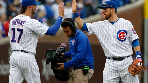 Chicago Cubs' Kris Bryant, left, celebrates with Ben Zobrist after they defeated the Milwaukee Brewers in a baseball game in Chicago, Sunday, May 21, 2017. (AP Photo/Nam Y. Huh)