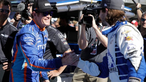 Scott Dixon, left, of New Zealand, is congratulated by JR Hildebrand after winning the pole during qualifications for the Indianapolis 500 IndyCar auto race at Indianapolis Motor Speedway, Sunday, May 21, 2017, in Indianapolis. (AP Photo/Darron Cummings)