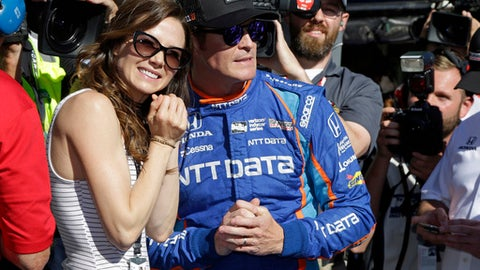 Scott Dixon, of New Zealand, watches with his wife, Emma, the final attempt to knock him off the pole during qualifications for the Indianapolis 500 IndyCar auto race at Indianapolis Motor Speedway, Sunday, May 21, 2017, in Indianapolis. (AP Photo/Michael Conroy)