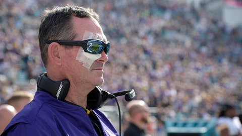 "FILE - In this Dec. 11, 2016, file photo, Minnesota Vikings head coach Mike Zimmer stands for the singing of the national anthem prior to an NFL football game against the Jacksonville Jaguars, in Jacksonville, Fla. Zimmer will be taking some time away from the team to recover from multiple eye surgeries. The Vikings say Zimmer is expected to return ""in a few weeks."" Zimmer has undergone eight surgeries on his right eye, where he suffered a detached retina, since Nov. 1. (AP Photo/Phelan M. Ebenhack)"