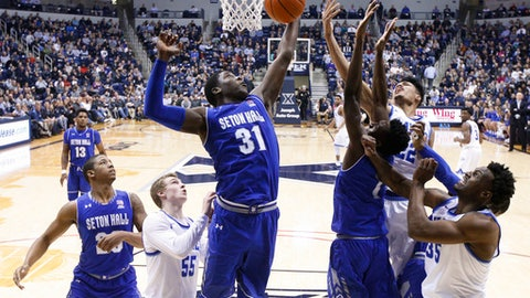FILE - In this Feb. 1, 2017, file photo, Seton Hall's Angel Delgado (31) grabs a rebound in the first half of an NCAA college basketball game against Xavier, in Cincinnati. Delgado has withdrawn from the NBA draft and will return for his senior season.  Delgado announced the news in a statement released by the Big East Conference school Monday, May 22, 2017. (AP Photo/John Minchillo, File)
