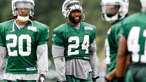 New York Jets cornerback Darrell Revis (24) laughs during NFL football training camp on Wednesday, Aug. 3, 2011, in Florham Park, N.J. (AP Photo/Julio Cortez)
