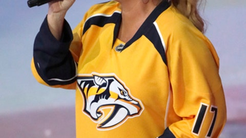 Trisha Yearwood performs the National Anthem before Game 6 of the Western Conference final in the NHL hockey Stanley Cup playoffs Monday, May 22, 2017, in Nashville, Tenn. (AP Photo/Mark Humphrey)
